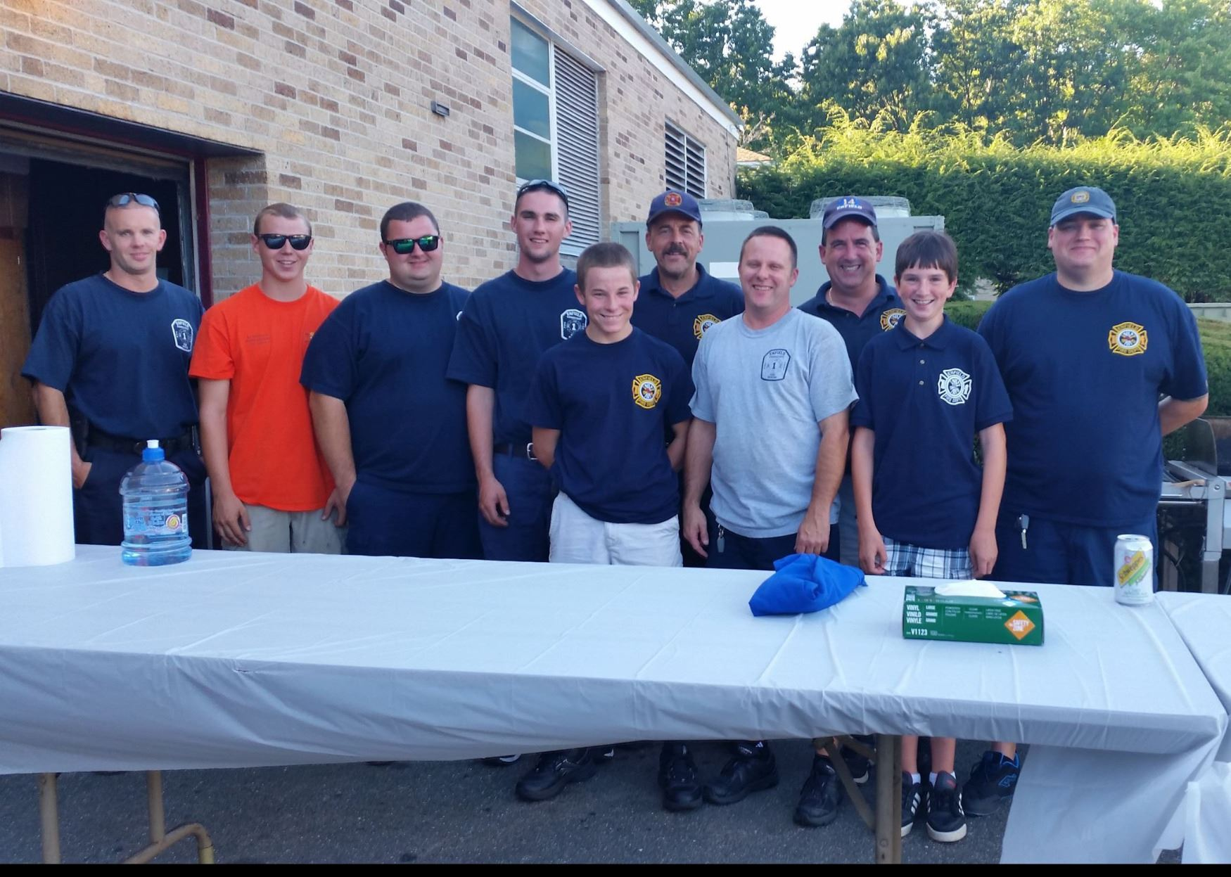 Firefighters pose while helping cook at the Holy Family Church