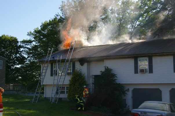 Flames rise from the roof during the Campania Road House Fire